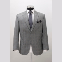 The wedding suit made of Dormeuil's 130's Summer Amadeus fabric with hybrid light construction in Italian style and cut.